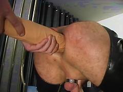 Two slaves take turns having their holes abused