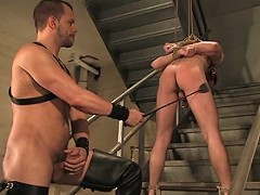 Studly Chad Manning spanks and fucks newcomer Kain Warn in tight bondage.